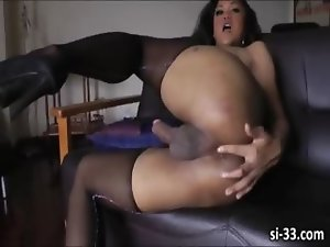 Ladyboy Ming fingers ass and jerks off